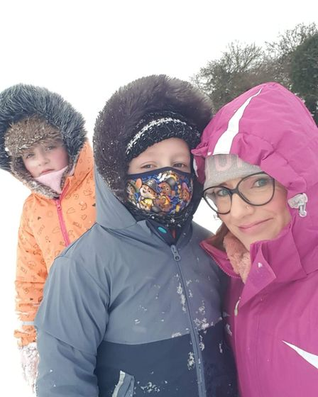 Kerry Anne Cator with her children in the snow, Fakenham