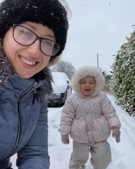 Paige and her daughter, Hazel in the snow