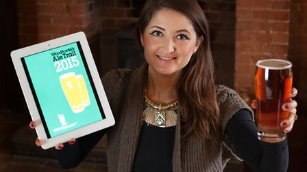 Rachael Shakespeare, Woodforde's marketing manager, showcases the new Woodforde's Ale Trail App.