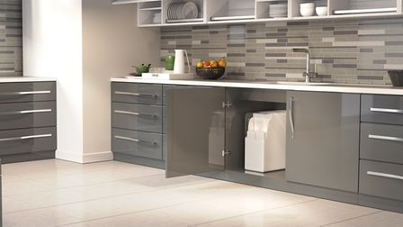 A water softener from Patmore Water Softeners in a modern kitchen