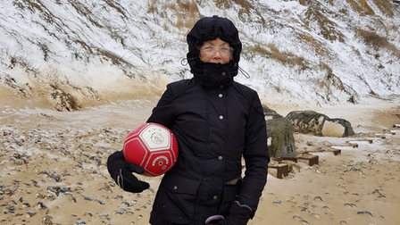Di Miller from West Runton with aAFC Ajax football found on the beach there.