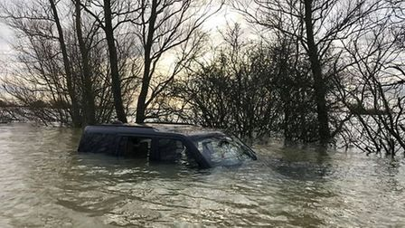 Stranded 4X4 in the water on Welney Wash Road.