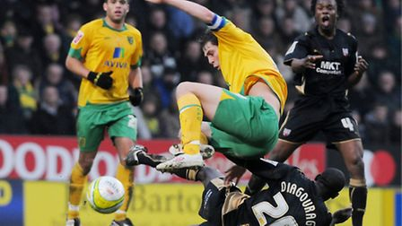 FROM THE ARCHIVE: Grant Holt goes in for a tackle which earns him a second yellow, and a 41st-minute