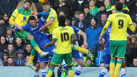 Michael Turner wins a header on his recall to the Norwich City side against Cardiff. Picture by Paul