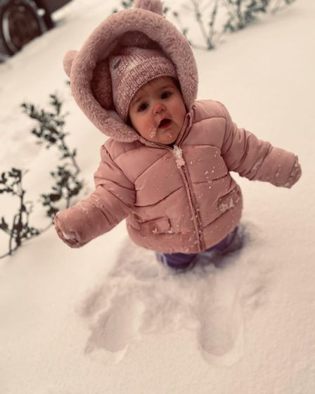 Emily Olding's daughter Isabella, 11 months, enjoyed waddling in the snow