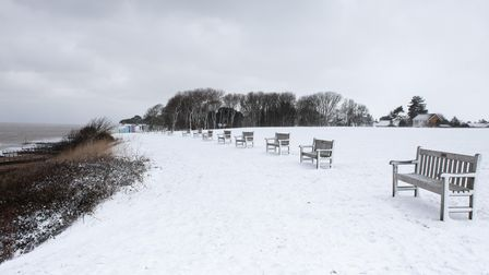 Empty benches in Felixstowe as snow continues to fall due to Storm Darcy
