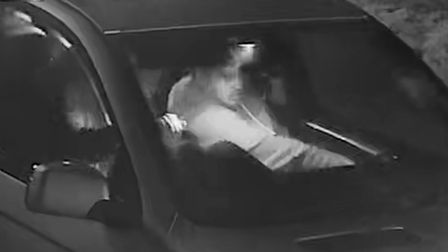 Essex Police want to speak to the man in the CCTV footage in connection with the death of a motorcyclist in St Osyth