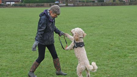 AliSteward, owner of Fur and Simple Pet Services, with her customers dog Freddie.
