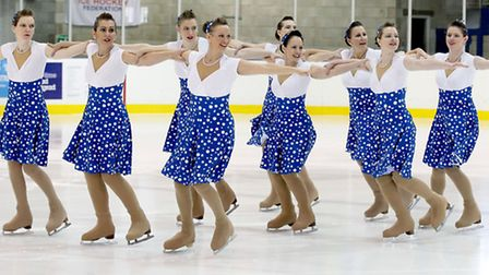 Corrina Haylett with her iceskating team, Fusion, competing in the rink.
