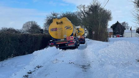 An oil tanker is blocking Mill Road in Badingham after becoming stuck in a ditch.