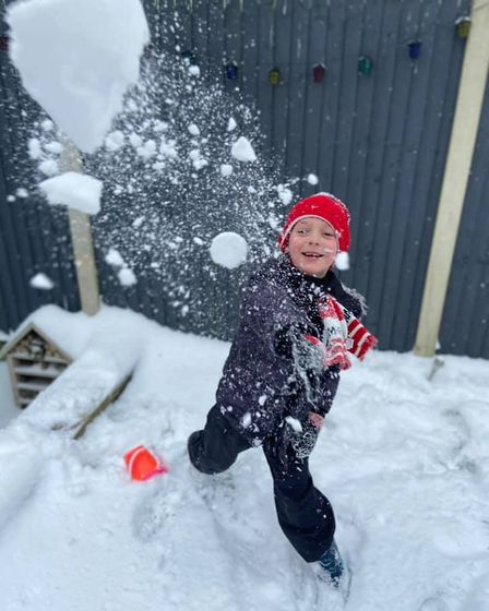 Jamie throwing a snowball at his mum in Reepham