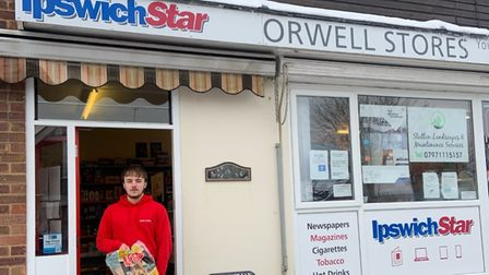 Lewis Fratel, manager of Orwell Stores in Chelmondiston, with a bag of heat logs. Deliveries of fuel have been in demand...