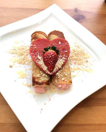Surprise your loved one with a sweet, strawberry-filled pancake