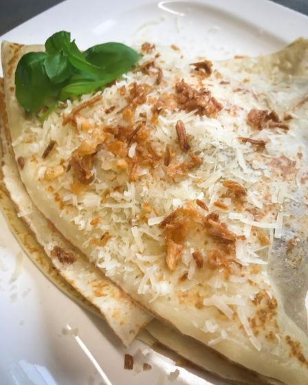 Jana's savoury pancakes with chicken and mushroom, topped off withparmesanand crispy onion