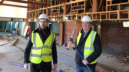 Tim Sweeting, YMCA Norfolk CEO (leftt), as work starts to transform the former Jubilee Hall into com