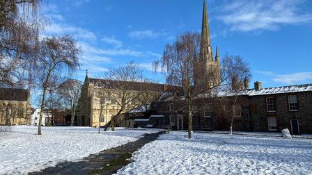 Norwich Cathedral grounds completely covered in snow