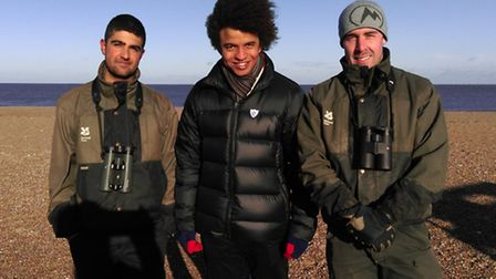 From left to right Ajay Tegala with the Blue Peter presenter Radzi Chinyanganya and George Baldock o