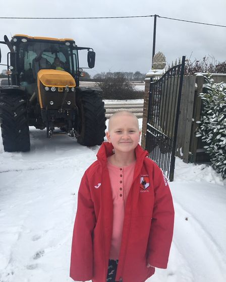 Hannah Stokes, 10, pictured with the nurse's tractor.