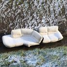 The cream sofa was found abandoned in a muddy ditch along Upwell Road in March.