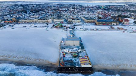 (C)2021THURNE STUDIOSwww.thurnestudios.comGreat Yarmouth Brittannia pier in the snow, Icy and sil