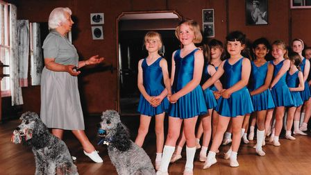 poodles and ballet dancers with their teacher