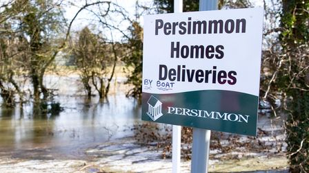 Homes for sale sign at Showfields, Whittlesey, with 'modification' provided by a local prankster