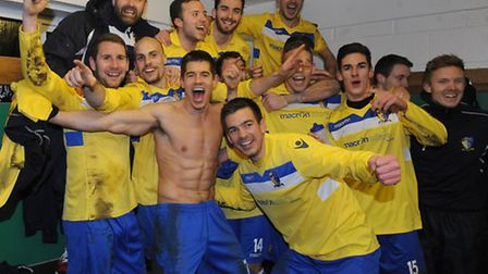 The players of Norwich United celebrate following their victory in the FA Vase match at Homelands St