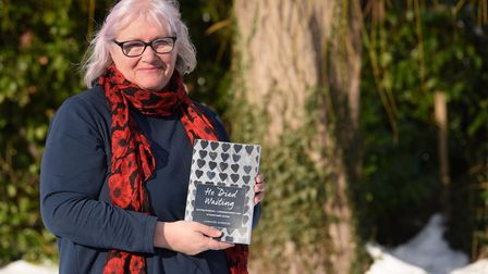Caroline Aldridge with her book He Died Waiting about her son Tim. Picture: DENISE