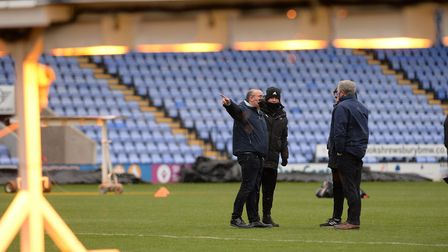 Paul Lambert and Stuart Taylor talk to Shrewsbury Town officials after the game was postponed.