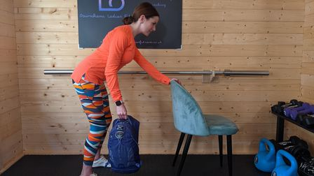 Lisa Jarratt of Downham Ladies Fitness using items found in the home for a body workout.