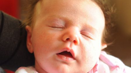 Four-weeks-old Alana Heelas who was helped into the world by paramedics during her traumatic birth a
