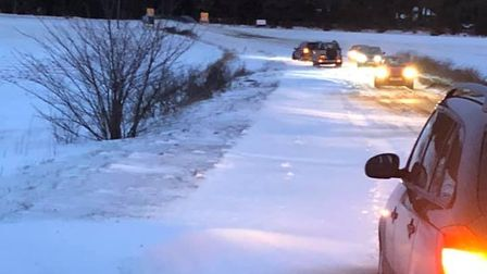 Drivers stuck in a snowdrift on the A148