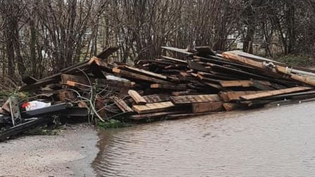 The scene that confronted villagers in Barcham after this load of rubbish was dumped in a road