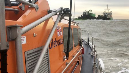 Lowestoft RNLI Lifeboat taking theRoyal Navy divers to the dredger to deal with wartime ordnance.
