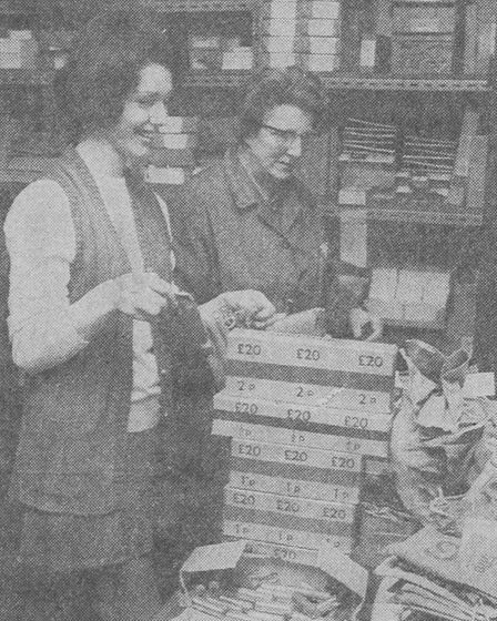 Accounts staff at Curls department store in Norwich sort out boxes of new coins.