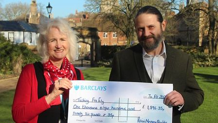 Rosie Holliday is pictured handing over the cheque to Anthony Sigrist, who is the founder of Talking FreELY.
