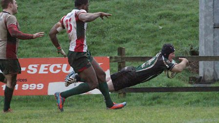 Shane van Vuuren goes over for the only try of the game for North Walsham at Luton. Picture: Hywel J