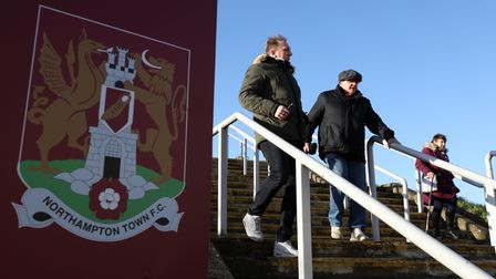 Northampton Town fans make their way to the ground for the match, before the Sky Bet League One matc