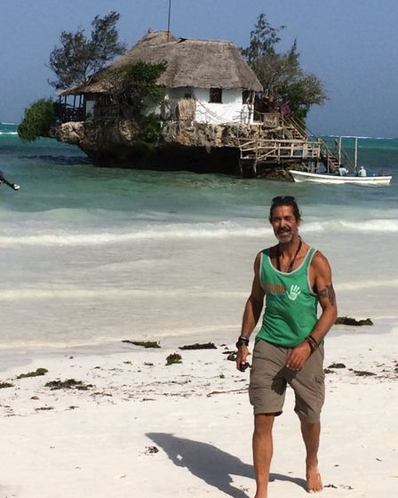 Andy Smith, 52, on the beach in Zanzibar, where he travelled to with his sister Deb.