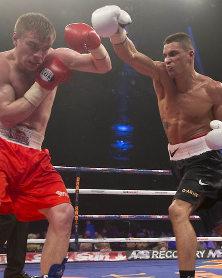 Anthony Ogogo (right) in action against Greg O'Neil during their Middleweight bout at the SECC, Glas