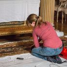 House Steward Ellie Hobbs cleaningthe state bedroom carpet at Blickling. A new trial is about to be launched to protect carpets and other textiles at Blickling from the common clothes moth.