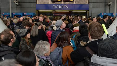 Travellers are locked out of Finsbury Park station, London, where they were directed to go as trains