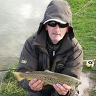 Mark Nielson returning a nice brown trout that he caught.