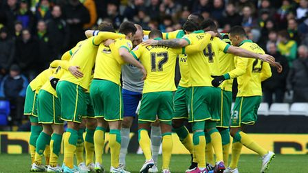 The Norwich City team in the pre-match huddle before the game at Birmingham City. Picture: Paul Ches