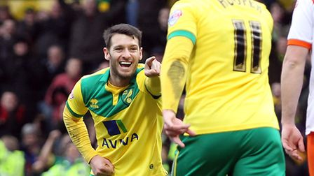 Gary Hooper celebrates his second goal with Wes Hoolahan. Picture: Paul Chesterton/Focus Images