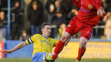 King's Lynn Town v Skelmersdale at The Walks - David Bridges challenges for the ball. Picture: Matth