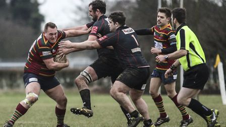Philip Scott in the thick of the action for Norwich during their narrow win over Rochford Hundred at