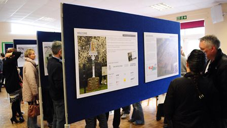 Visitors examining the proposals for the new homes development in Easton which were on show in the v