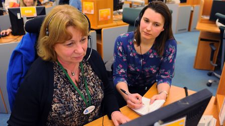 The 111 emergency out of hours contact centre. Reporter Sophie Wylie chats to Anne Grand, left, 111