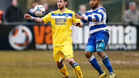 Jack Ainsley of Lowestoft Town (left) competing with Adi Yussuf of Oxford City (right) during the Co